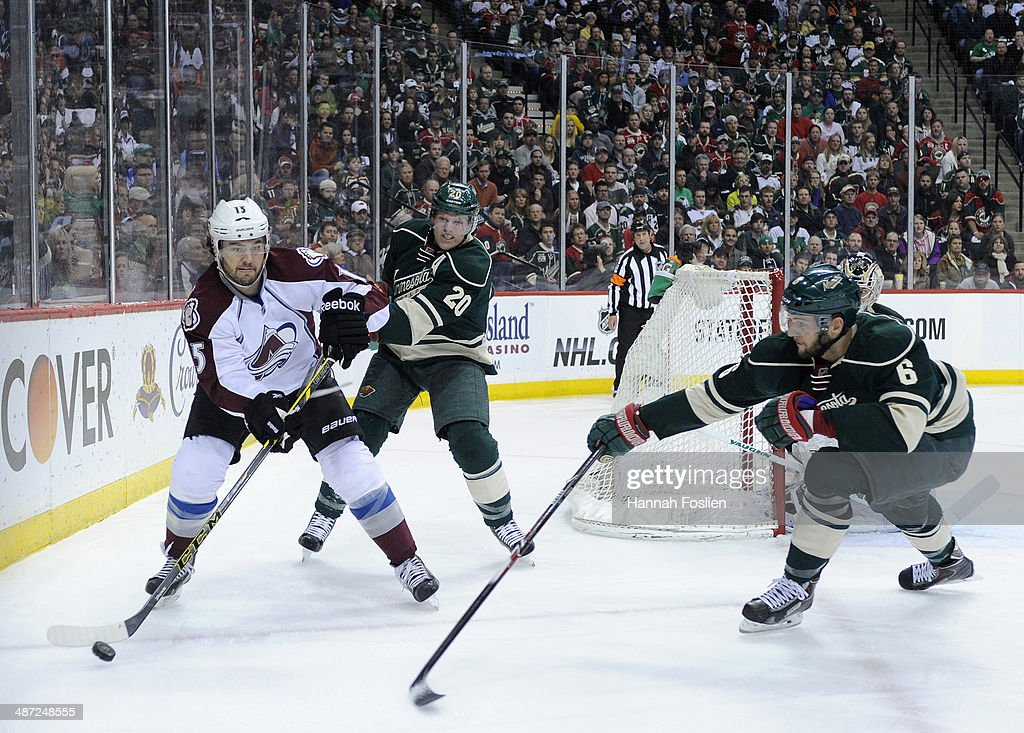 P.A. Parenteau #15 of the Colorado Avalanche passes the puck away from Ryan Suter #20 and Marco Scandella #6 of the Minnesota Wild during the first period in Game Six of the First Round of the 2014 NHL Stanley Cup Playoffs on April 28, 2014 at Xcel Energy Center in St Paul, Minnesota. The Wild defeated the Avalanche 5-2.