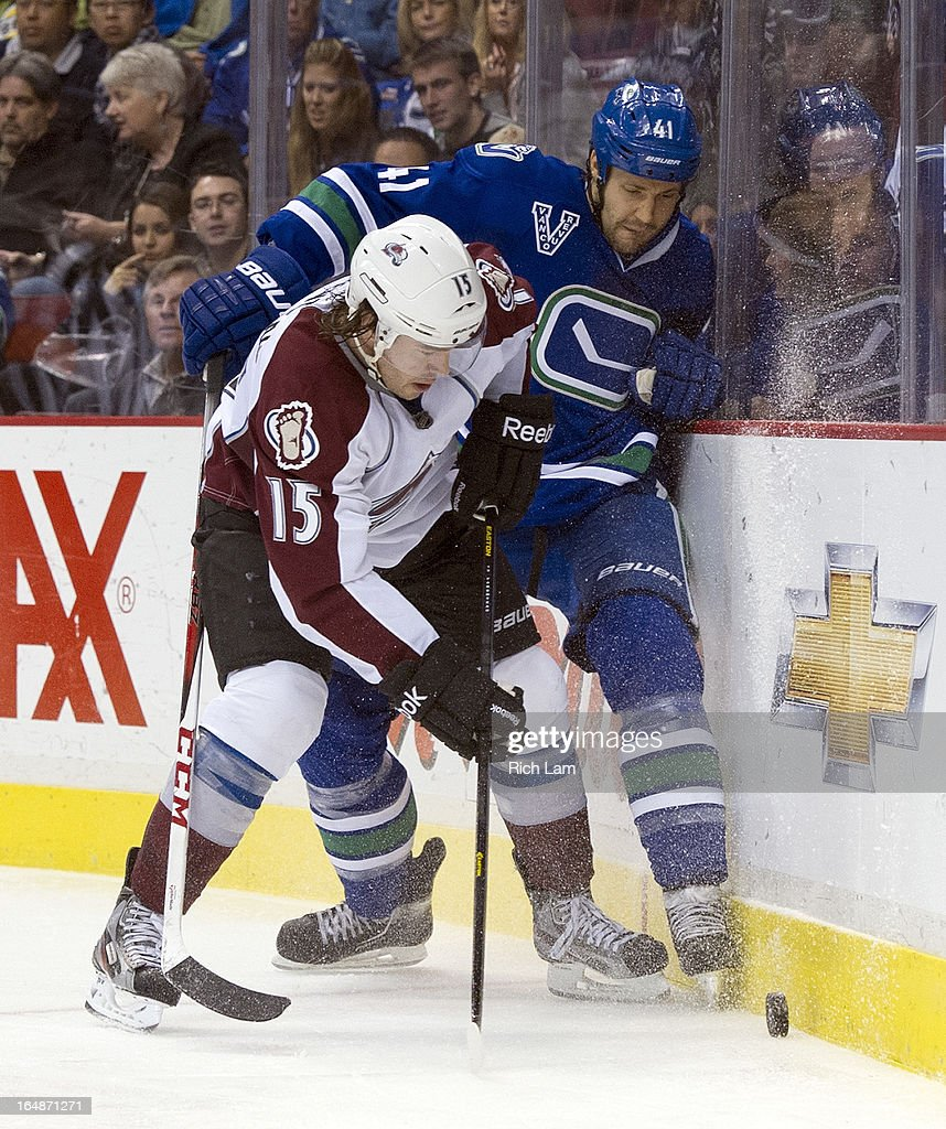 PA Parenteau #15 of the Colorado Avalanche pins <a gi-track='captionPersonalityLinkClicked' href=/galleries/search?phrase=Andrew+Alberts&family=editorial&specificpeople=622259 ng-click='$event.stopPropagation()'>Andrew Alberts</a> #41 of the Vancouver Canucks along the end boards while battling for the puck during the third period in NHL action on March 28, 2013 at Rogers Arena in Vancouver, British Columbia, Canada.