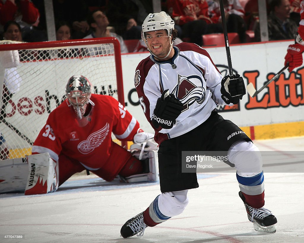 A Parenteau of the Colorado Avalanche pumps his fists after scoring on goalie Jimmy Howard of the Detroit Red Wings during an NHL game on March 6...