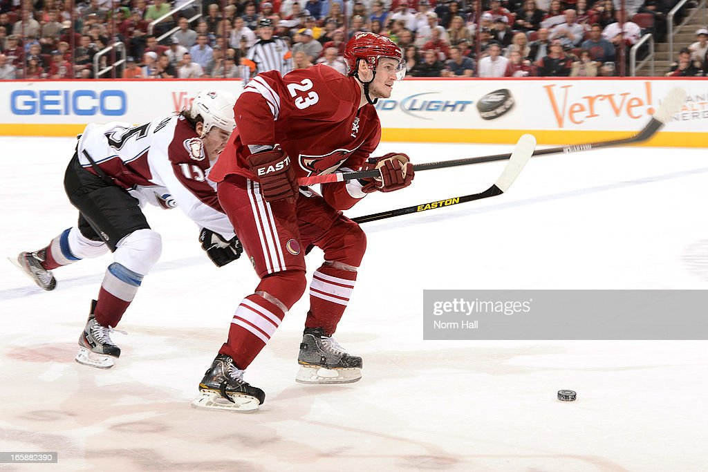 PA Parenteau #15 of the Colorado Avalanche reaches in to steal the puck from <a gi-track='captionPersonalityLinkClicked' href=/galleries/search?phrase=Oliver+Ekman-Larsson&family=editorial&specificpeople=5894618 ng-click='$event.stopPropagation()'>Oliver Ekman-Larsson</a> #23 of the Phoenix Coyotes during the second period at Jobing.com Arena on April 6, 2013 in Glendale, Arizona.