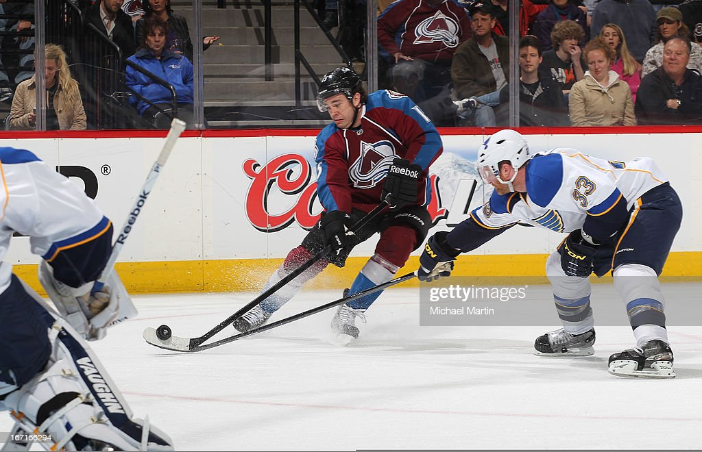 PA Parenteau #15 of the Colorado Avalanche shoots the puck while <a gi-track='captionPersonalityLinkClicked' href=/galleries/search?phrase=Jordan+Leopold&family=editorial&specificpeople=201885 ng-click='$event.stopPropagation()'>Jordan Leopold</a> #33 of the St Louis Blues defends at the Pepsi Center on April 21, 2013 in Denver, Colorado. The Avalanche defeated the Blues 5-3.