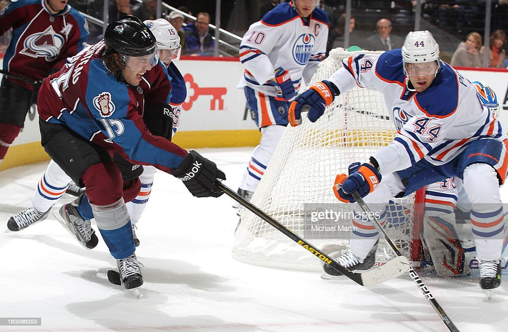 PA Parenteau #15 of the Colorado Avalanche skates against <a gi-track='captionPersonalityLinkClicked' href=/galleries/search?phrase=Corey+Potter&family=editorial&specificpeople=2339200 ng-click='$event.stopPropagation()'>Corey Potter</a> #44 of the Edmonton Oilers at the Pepsi Center on March 12, 2013 in Denver, Colorado. Edmonton defeated Colorado 4-0.