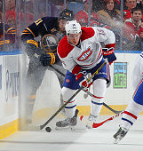 A Parenteau of the Montreal Canadiens controls the puck in front of Andrej Meszaros of the Buffalo Sabres on November 5 2014 at the First Niagara...