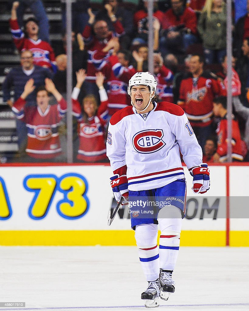 P.A. Parenteau #15 of the Montreal Canadiens reacts after scoring the game-winning goal against the Calgary Flames during an NHL game at Scotiabank Saddledome on October 28, 2014 in Calgary, Alberta, Canada. The Canadiens defeated the Flames 2-1 in shootout.