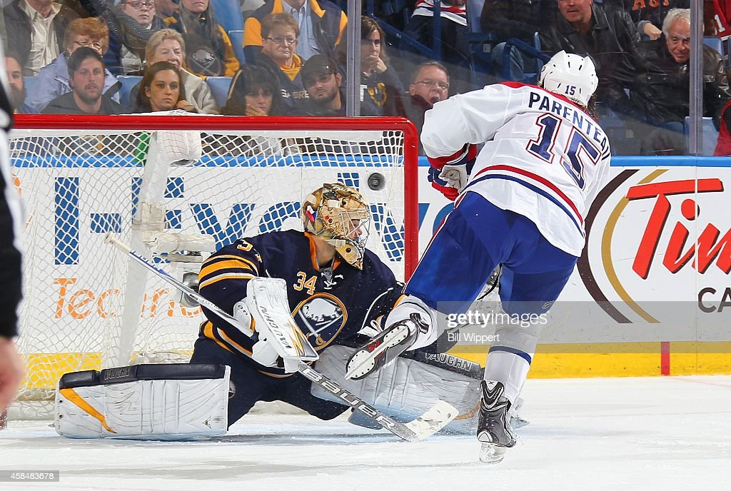 A Parenteau of the Montreal Canadiens scores the game winning shootout goal against Michal Neuvirth of the Buffalo Sabres on November 5 2014 at the...
