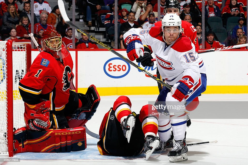 PA Parenteau #15 of the Montreal Canadiens skates by Jonas Hiller #1 of the Calgary Flames at Scotiabank Saddledome on October 28, 2014 in Calgary, Alberta, Canada.