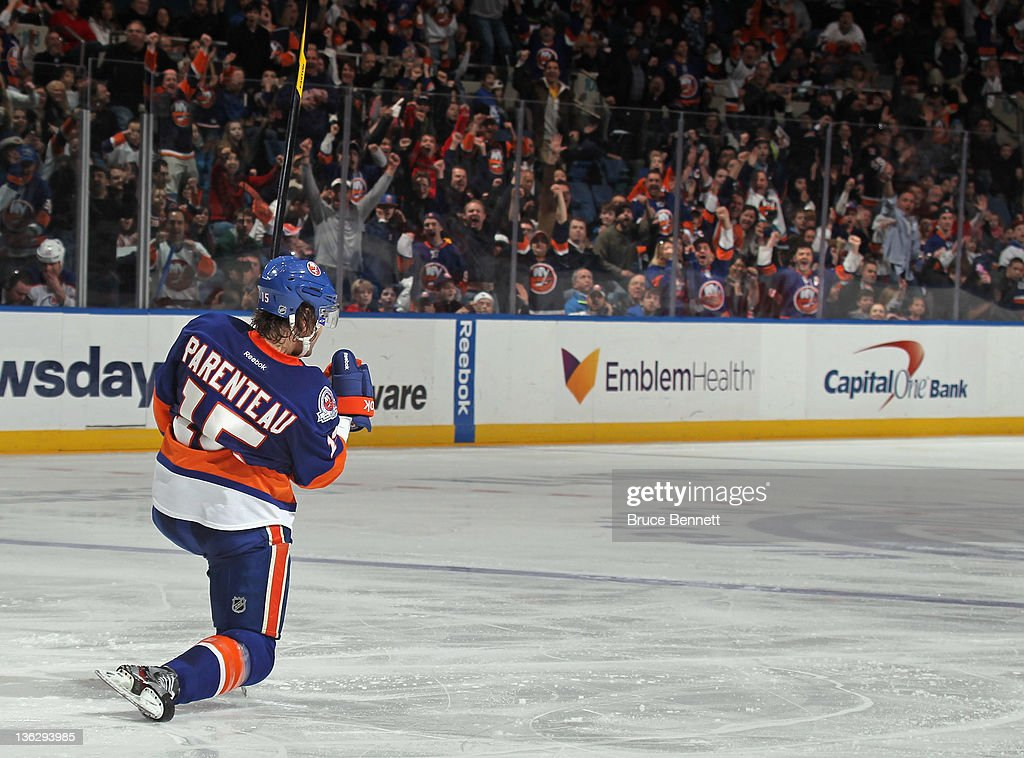 P.A. Parenteau #15 of the News York Islanders scores a powerplay goal at 3:19 of the second period against the Edmonton Oilers at the Nassau Veterans Memorial Coliseum on December 31, 2011 in Uniondale, New York.