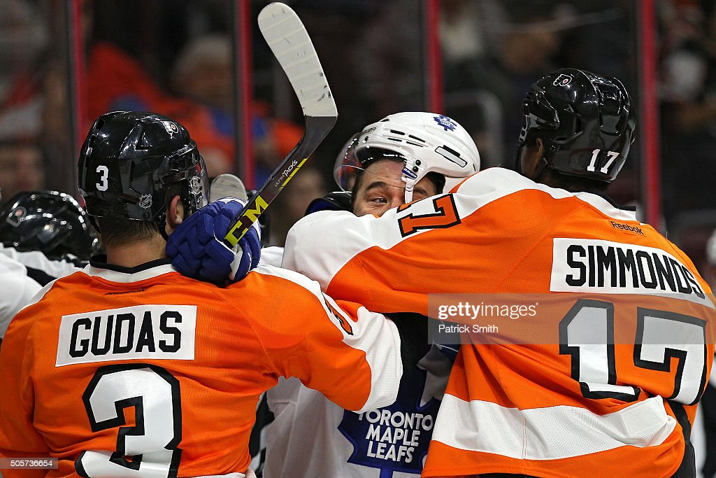 P.A. Parenteau #15 of the Toronto Maple Leafs is pushes around by Wayne Simmonds #17 and Radko Gudas #3 of the Philadelphia Flyers during the first period at Wells Fargo Center on January 19, 2016 in Philadelphia, Pennsylvania.