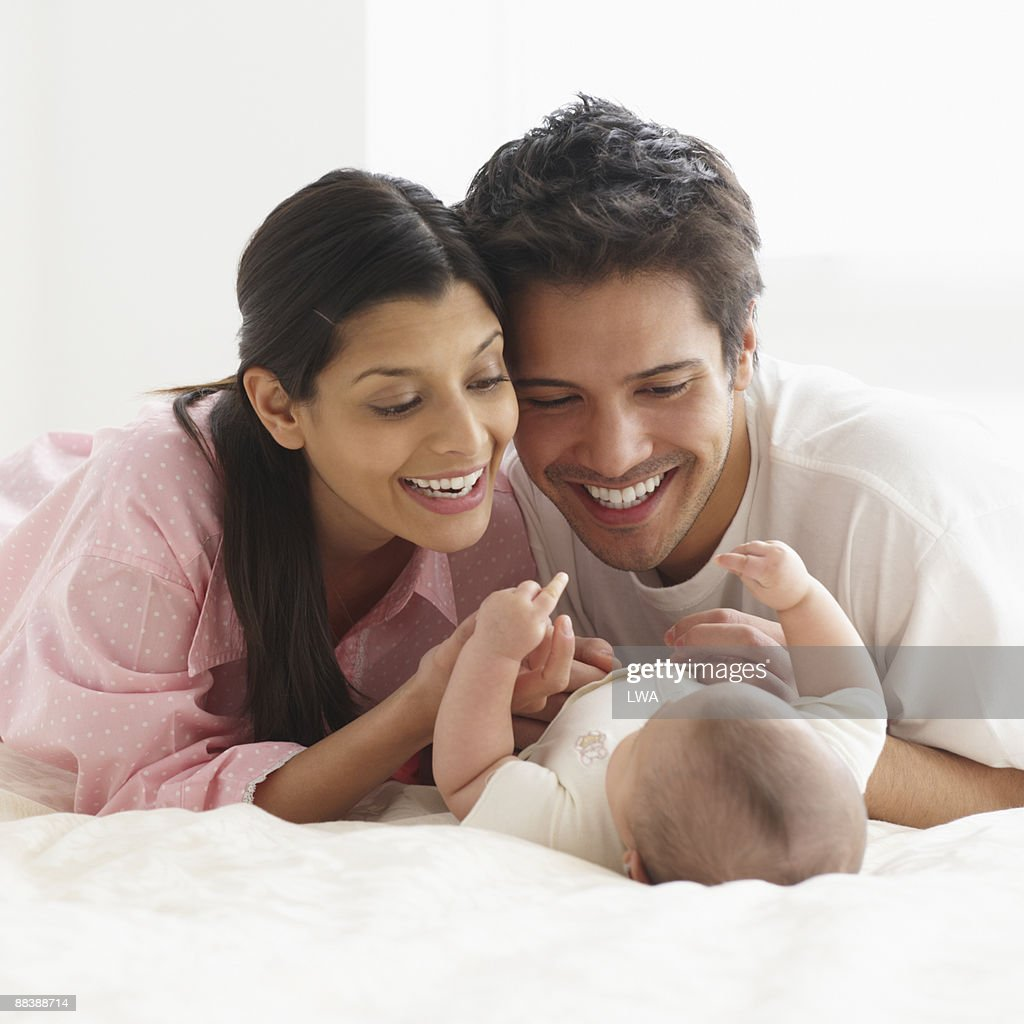 Parents Admiring Infant Daughter : Stock Photo