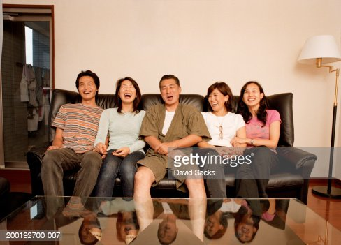 Parents and adult children laughing : Stock Photo