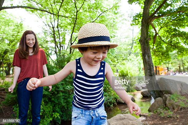 Parents and children are happily laughing at park
