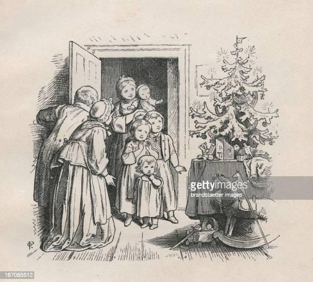 Parents and children celebrating under the Christmas tree Steel engraving from Oscar Pletsch Jahr ein Jahr aus im Elternhaus 1861 Dresden Verlag von...