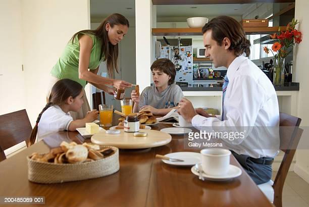Parents and children (7-11) having breakfast