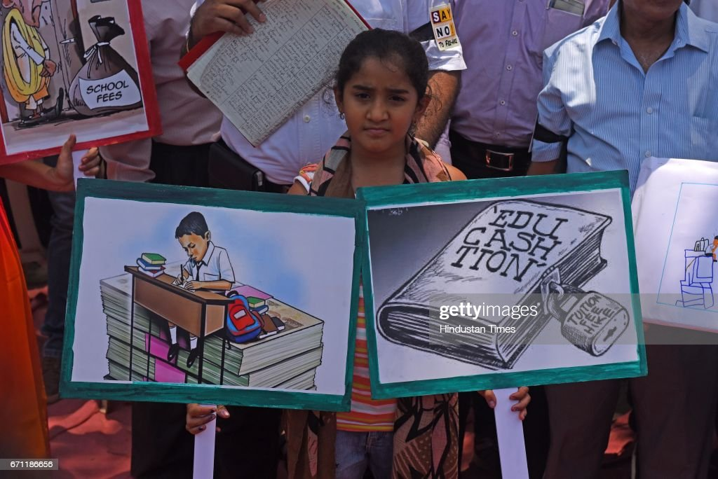 Parents and children protest against the exorbitant fee hike and collection of huge amount of un-approved and illegal fees by private schools at Azad Maidan, on April 20, 2017 in Mumbai, India. The parents have demanded that the district administration put in place a mechanism to ensure that private schools do not unjustifiably increase their fees. They have also demanded that there should be no increase in fees for academic year 2017-18 and the coming three years.