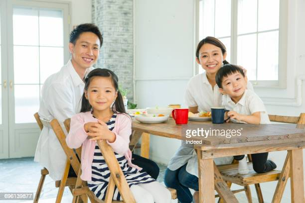 Parents and children smiling at table