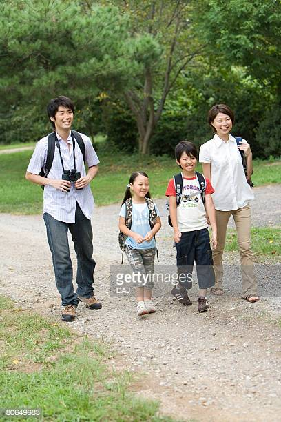 Parents and children walking a path, summer