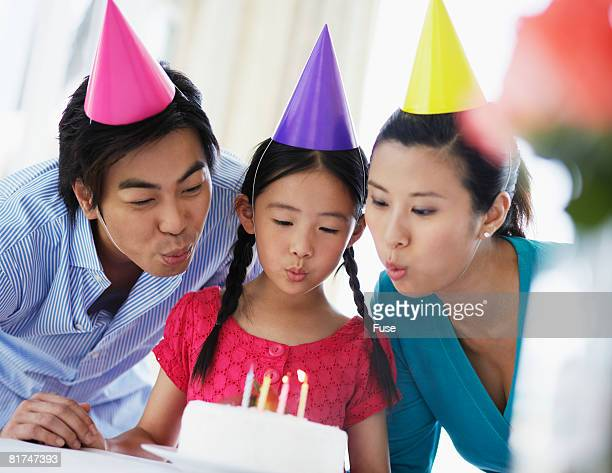 Parents and Daughter Having Birthday Party