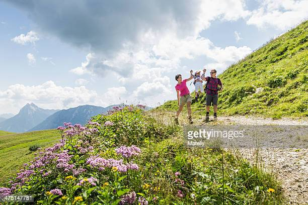 Parents and daughter having fun on walk, Tyrol, Austria