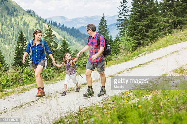 Parents and daughter hiking, Tyrol, Austria