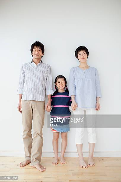 Parents and daughter standing