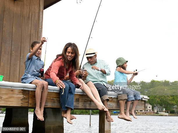 Parents and daughters (8-10) fishing from dock