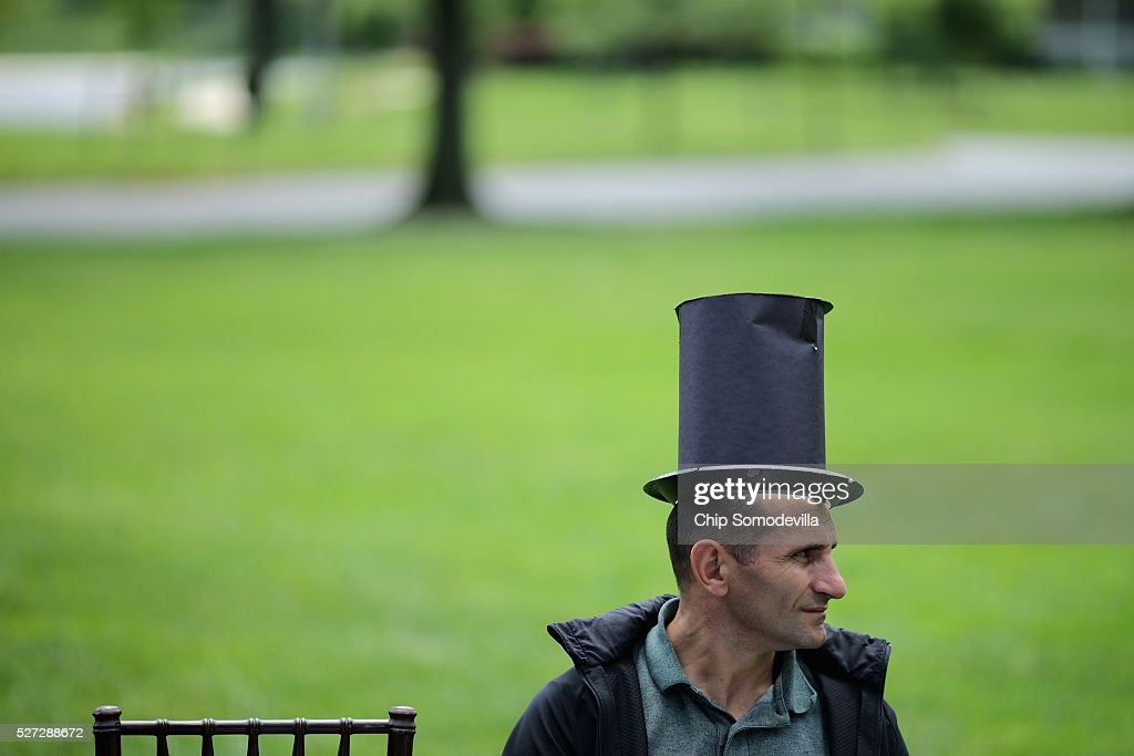 Parents and grandparents, some wearing hand-made paper stovepipe hats in the style of President Abraham Lincoln, wait for the start of a childrens citizenship ceremony at President Lincoln's Cottage at the Soldiers' Home May 2, 2016 in Washington, DC. Twenty one children from 19 countries, including Syria, South Korea and El Salvador, became new United States citizens during the ceremony sponsored by the U.S. Citizenship and Immigration Services. President Abraham Lincoln and his family resided seasonally on the grounds of the Soldiers' Home to escape the heat and politics of downtown Washington, as did President James Buchanan before him and presidents Rutherford B. Hayes and Chester A. Arthur from 1885 to 1887.