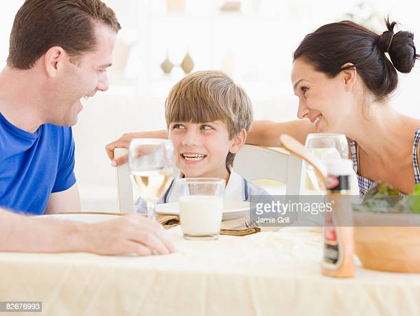 Parents and son eating dinner together