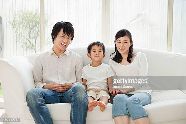 Parents and son on sofa, portrait