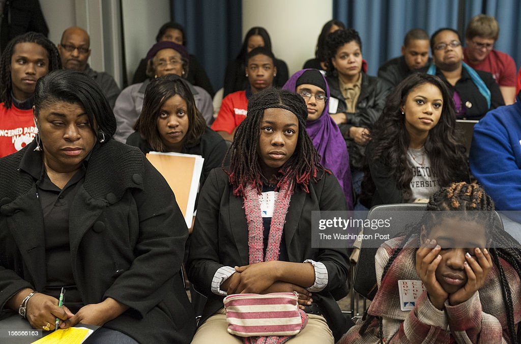 Parents and students listen as DC Public Schools Chancellor Kaya Henderson is questioned at the Wilson Building Thursday, November 15, 2012 in Washington, DC. In the front row is Carol Fullard with Johnson Middle School, Andrea Dyer, 14, a Friendship Collegiate Academy student and Mia Hawkins, 12, a student at Johnson Middle School.