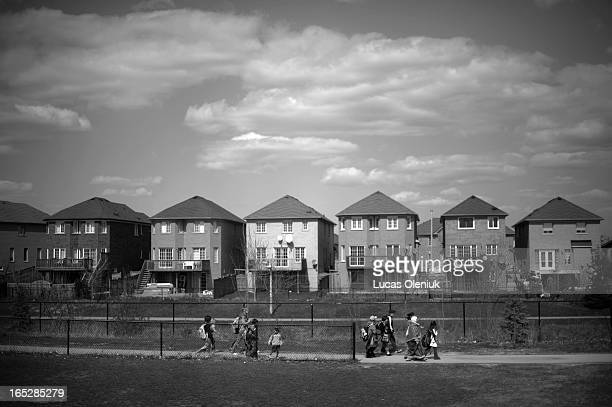 Parents and students walk home after the end of the school day at Brampton's Great Lakes Public School With an influx of young families in the area...