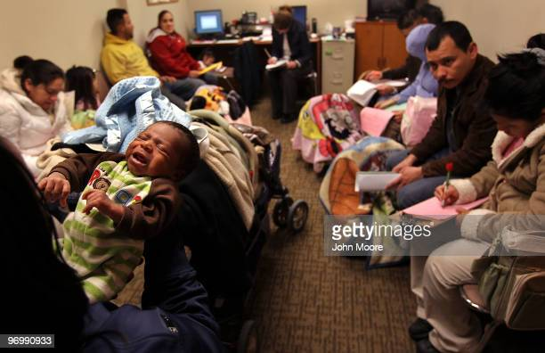 Parents and their babies wait for a newborn care class to begin on February 23 2010 in Aurora Colorado The Metro Community Provider Network which...