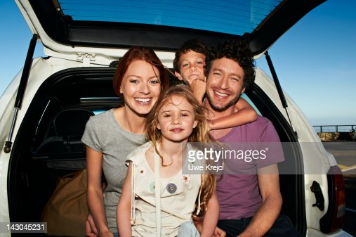 Parents and two children in family car, portrait : ストックフォト