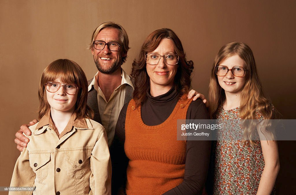 Parents and two children (9-11) wearing spectacles, smiling, portrait : Stock Photo