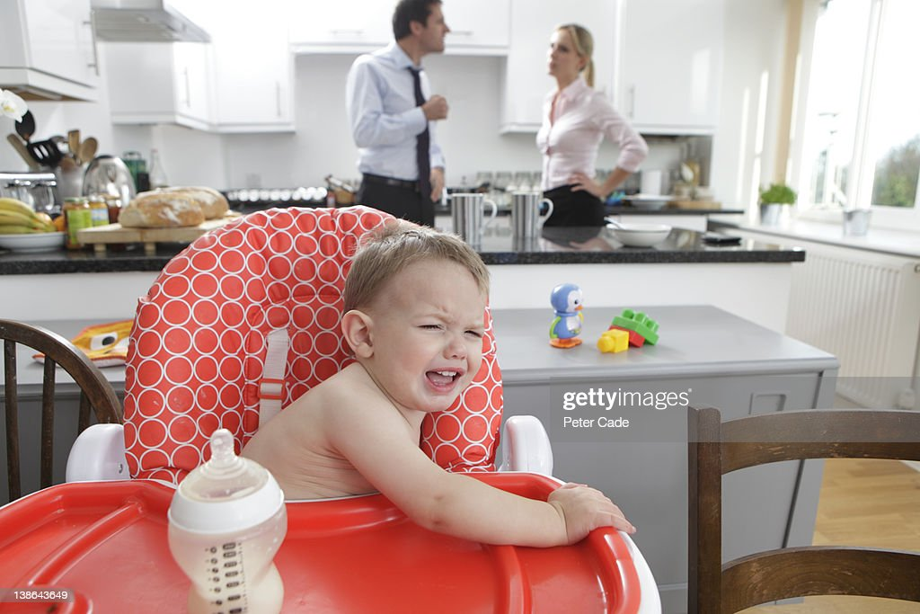parents arguing while baby crys : Stock Photo
