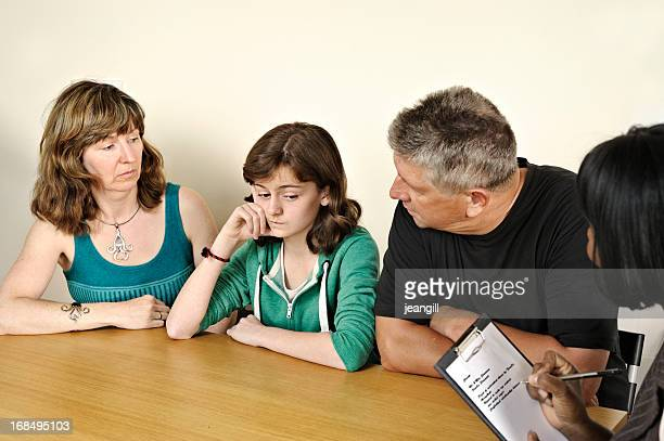 Parents attending a counseling session for their daughter