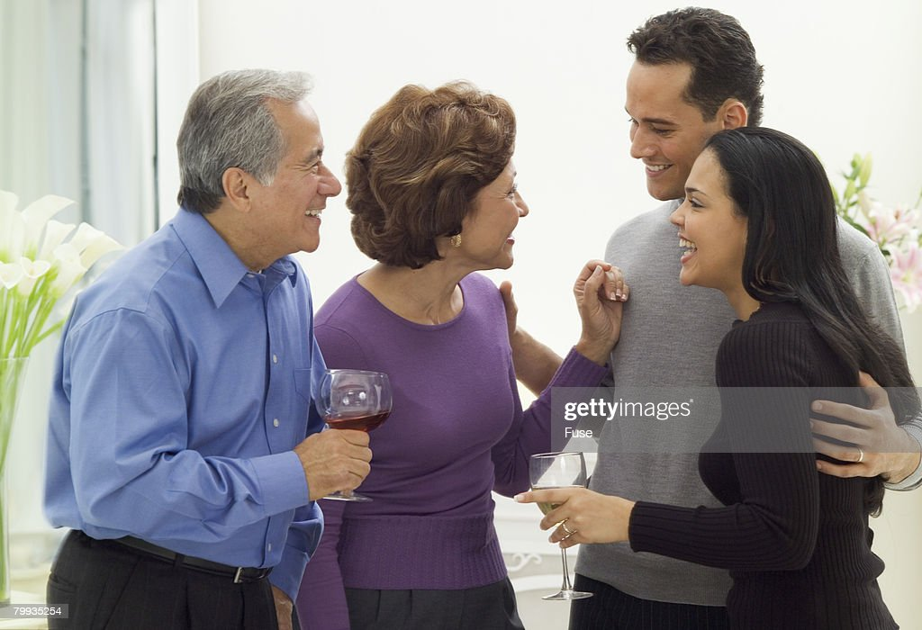 Parents Chatting with Child and Spouse