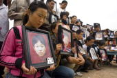 Parents grieve their children who died at Fuxin Primary School on May 22 2008 in Wufu Sichuan province China Nearly 7000 classrooms collapsed in the...