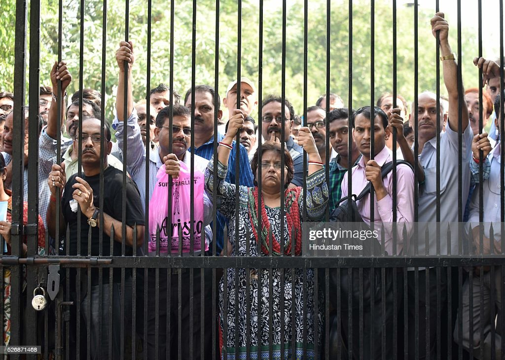 Parents hangs on the gate as their wards waits in queue to be thoroughly scanned who come to take the All India Pre-Medical/Pre-Dental Entrance Test (AIPMT) at the examination centre at RK Puram on May 1, 2016 in New Delhi, India. The All Indian Pre-Medical Test (AIPMT) 2016, being treated as the first phase of the National Eligibility Entrance Test (NEET), was held on Sunday. The competitive examination held for entrance to MBBS and BDS courses across the country was held amidst tight security this year. Students had a proper dress code to adhere to as they were not allowed to enter the examination hall in shoes or carry any kind of stationary with them. Mobile phones were also not allowed