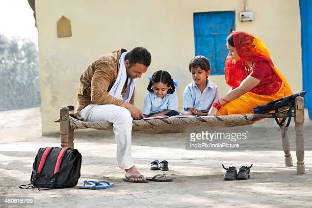 Parents helping children in homework