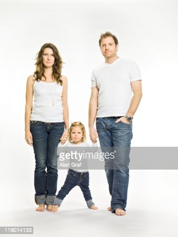 Parents holding daughters hand