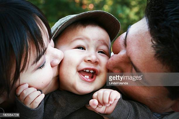 Parents Kissing Child