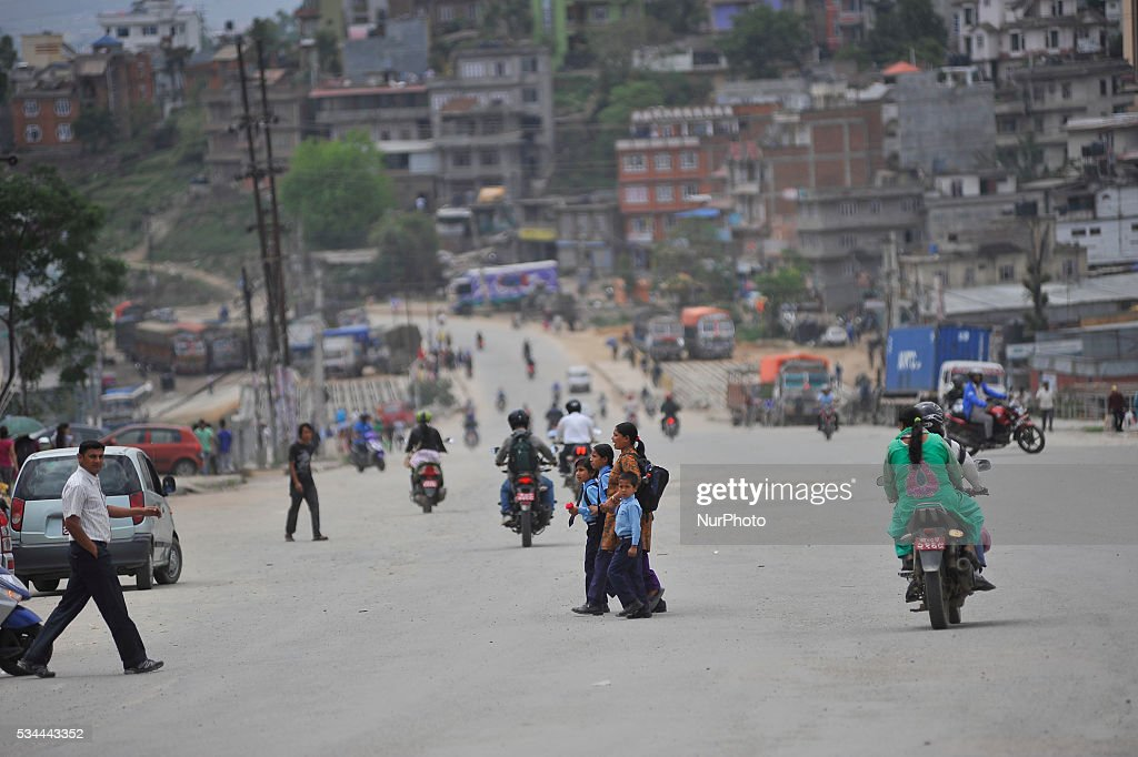 Parents leaving their children towards school as national-wide local transportation strike by transport entrepreneurs at Kalanki, Kathmandu on May 26, 2016.