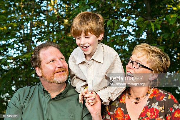 Parents looking at smiling son