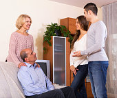 parents meeting girlfriend of their son at home