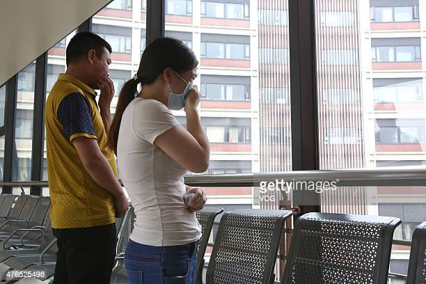 Parents of a pair of siamese girl twins worry before the twins receive separation surgery at Children's Hospital of Fudan University on June 9 2015...