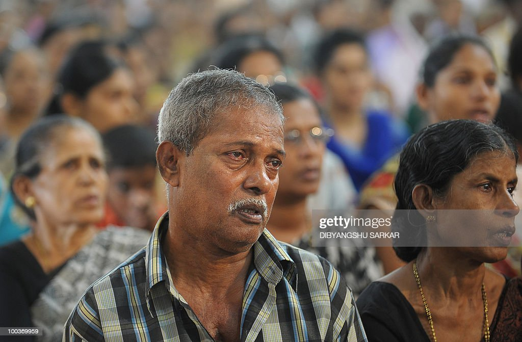 Parents of Air India Express crash victim Naveen Walton Fernandes attend a funeral service at the Holly Cross Church in Mangalore on May 24, 2010. Investigators on May 24 widened the search for the 'black box' data recorder of an Air India Express that crashed into a gorge killing 158 people, as the airline denied lax safety claims. Indian authorities said the cockpit voice recorder from the Boeing 737-800 was found late Sunday but the hunt was still on for the 'black box' that records all flight data and could hold the answer to the disaster. AFP PHOTO/Dibyangshu SARKAR