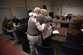 Parents of heroin and opioid addicts embrace during a family addiction support group on March 23 2016 in Groton CT The group Communities Speak Out...