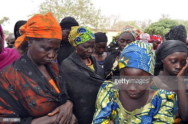 Parents of missing Chibok schoolgirls gather on April 14 2015 to mark the oneyear anniversary of the abduction of 219 schoolgirls by Boko Haram...