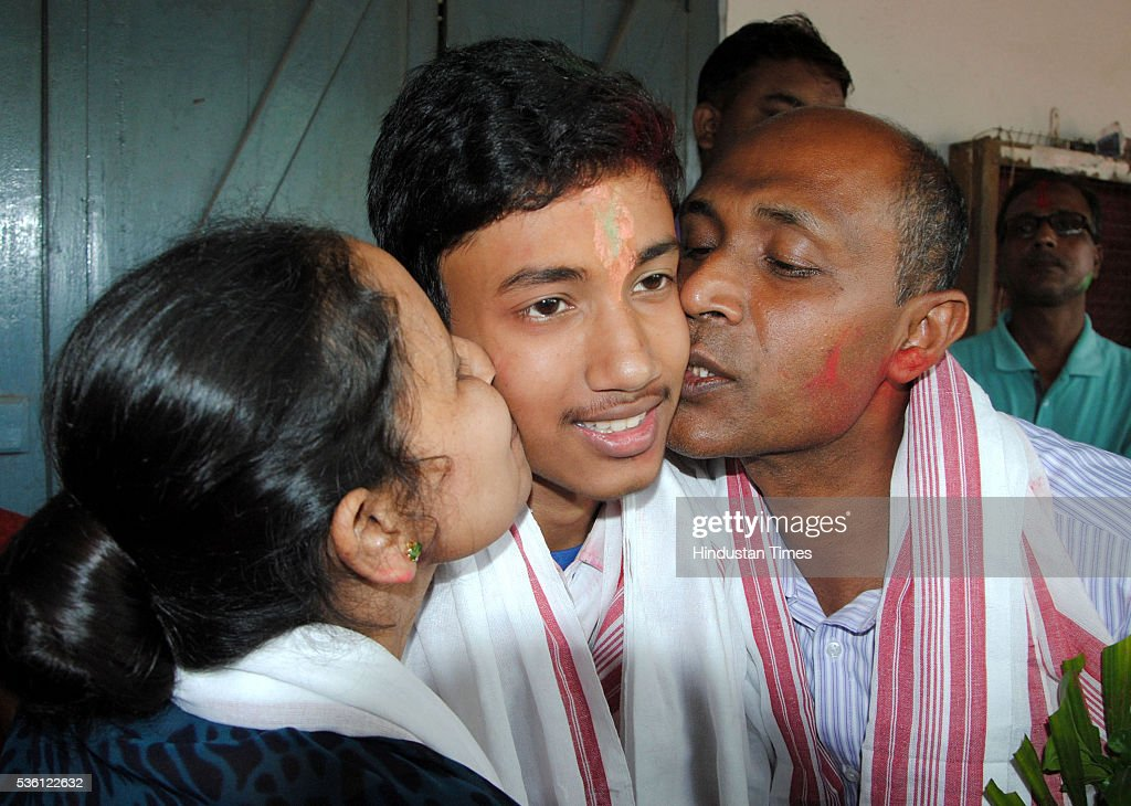 Parents of Sarfaraz Hussain who topped the Assam boards HSLC examination 2016 kissing him celebrating his success at school Sankardev Sishu Niketan, Betkuchi premises on May 31, 2016 in Guwahati, India. Sarfaraz who has scored 590 marks out of a maximum 600 in Class 10 exam is student of Sankardev Sishu Niketan school run by an affiliate of Vidya Bharati, the RSSs education wing.