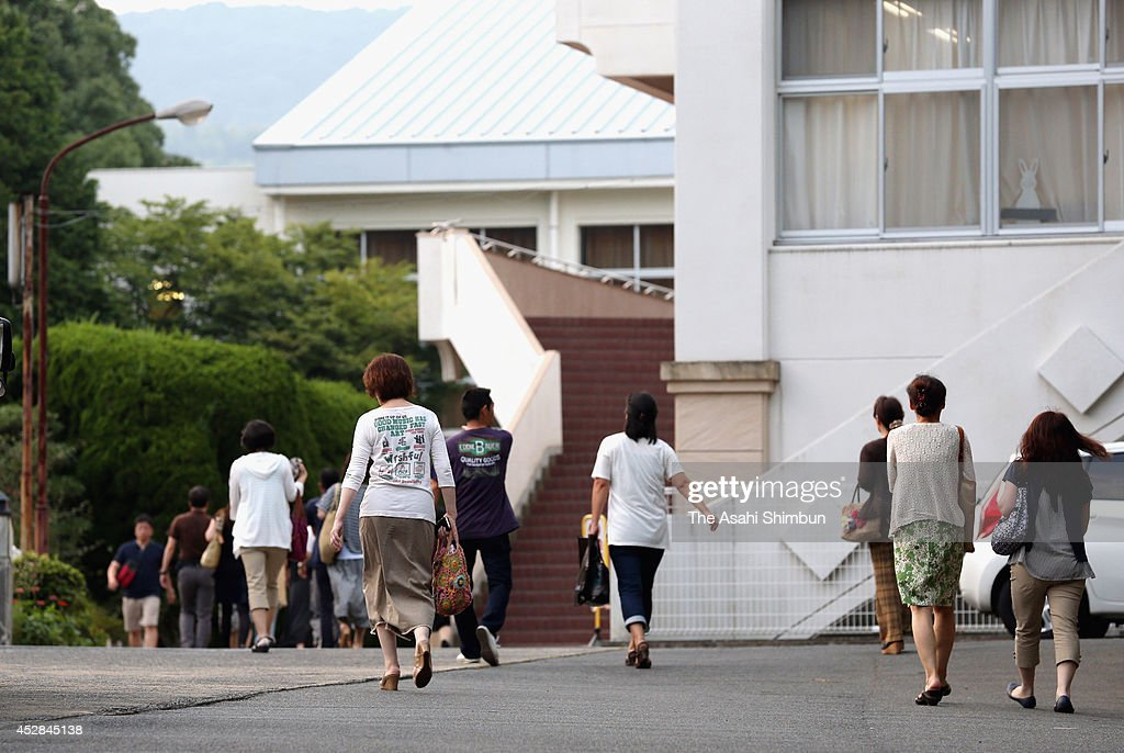 Parents of students of a high school where a 15- year-old girl killed her classmate and dismembered the body enter the school for an emergency meeting on July 28, 2014 in Sasebo, Nagasaki, Japan. According to the Nagasaki prefectural police, the student repeatedly struck the back of Aiwa Matsuo's head with a hand tool and strangled her with a rope in her apartment between 8 p.m. to 10 p.m. on July 26. Police confirmed the cause of death to be suffocation by cervical compression.